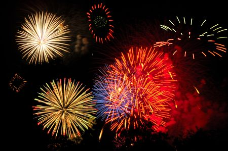 panoply: Panoply of colorful fireworks across the night sky Stock Photo