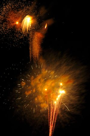showers: Fireworks display: rockets and showers of gold Stock Photo
