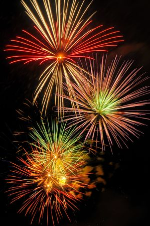panoply: Three colorful fireworks bursts on a black sky Stock Photo