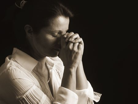 fervent: Beautiful woman with eyes closed in fervent prayer Stock Photo