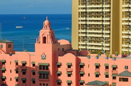 awnings: Waikikis historic Royal Hawaiian hotel with a parasail above the blue Pacific