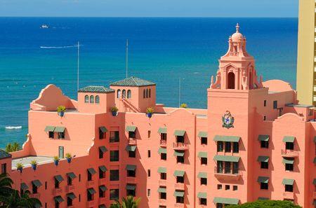 awnings: Waikikis historic Royal Hawaiian hotel against the blue Pacific Stock Photo