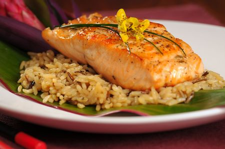 Fillet of broiled salmon on rice garnished Hawaiian style