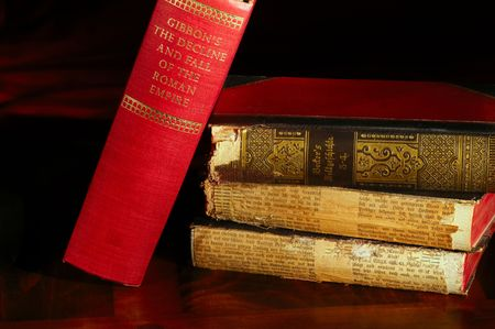 tomes: Classic volume leaning on a stack of German world history tomes, light painted Stock Photo