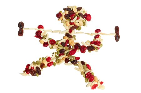 Cranberry raisin trail mix arranged in the shape of a weight lifter photo