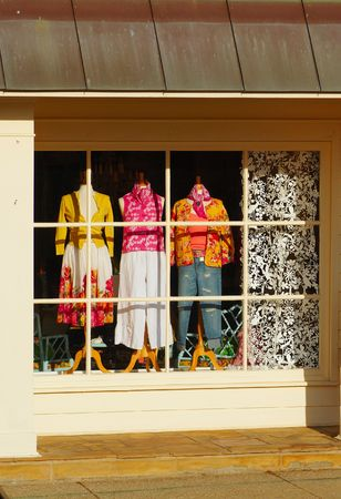 A shop window featuring a coloful fashion display