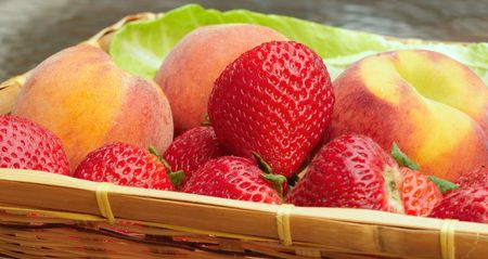 luscious: Wicker tray of luscious fresh strawberries and peaches