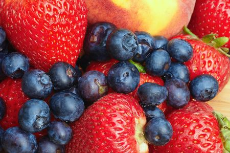 luscious: Closeup of luscious summer fruit medley: strawberries, peaches, blueberries Stock Photo