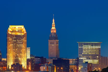 Close in view of downtown Cleveland lit up at night, just after sunset photo