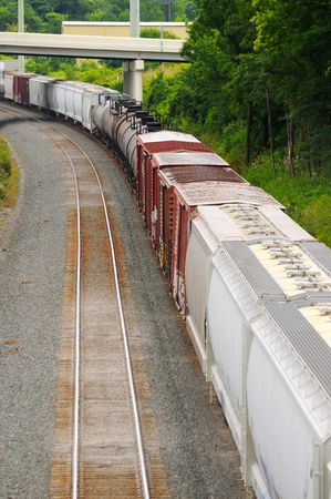A freight train rounding a curve, seen from above