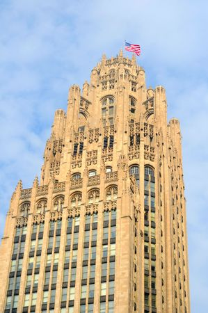 Chicagos old Tribune Tower with flag waving in the breeze photo