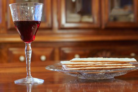 unleavened: Passover wine and matzoh on a table at eye level
