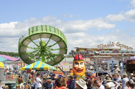 Burton, Ohio - September 5 - Tilt-a-whirl and other amusement rides at the 188th annual Great Geauga County Fair in Burton, Ohio, on September 5, 2010