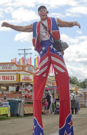 BURTON, OH - SEPT 5: A clown on stilts entertains at the 188th annual Great Geauga County Fair in Burton, Ohio, on September 5, 2010