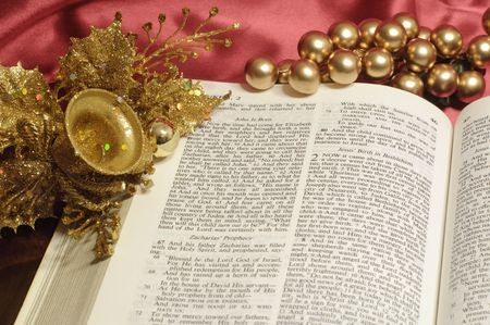 Bible open to the Christmas passage of Luke 2 with gold decor photo