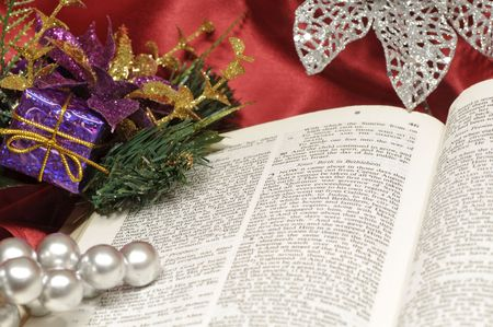 Bible open to the Christmas passage of Luke 2 with silver and colorful decor photo