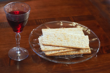 A glass of wine and plate of matzoh for Passover photo