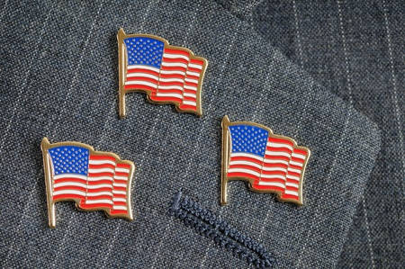 pin stripe: Three American flag pins on a pinstripe suit lapel Stock Photo
