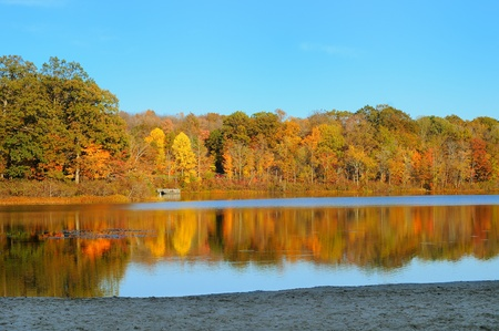 northeast ohio: Autumn colors reflected in a serene lake (Punderson Lake in northeast Ohio)