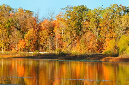 northeast ohio: Reflections of brilliant autumn colors in a serene lake (Punderson Lake in northeast Ohio)