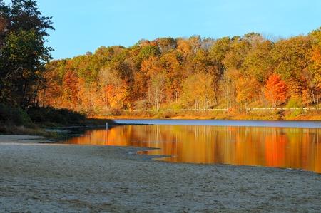 northeast ohio: Brilliant autumn colors reflected in a serene lake (Punderson Lake in northeast Ohio)