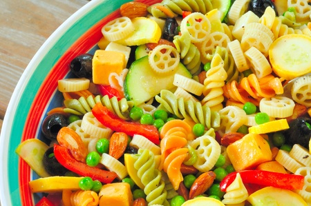 pasta salad: A delicious pasta salad on a picnic table - close overhead view Stock Photo