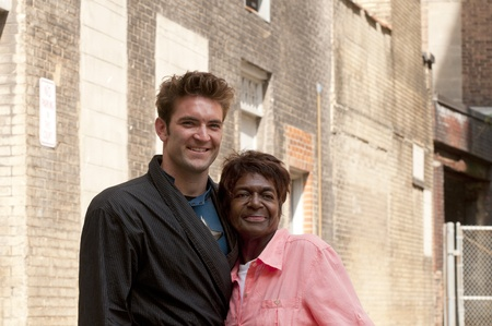 Cleveland - August 17, 2011: Stunt double for Chris Evans (Captain America) poses with a fan in a back alley on location of the filming of The Avengers in Cleveland.