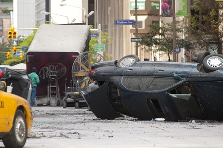 blockbuster: Cleveland - August 17, 2011: Wrecked vehicles set the scene for shooting of the blockbuster movie The Avengers on a street in Cleveland.
