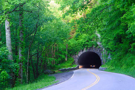 arches national park: Headlights emerging from a highway tunnel in Great Smoky Mountains National Park Stock Photo