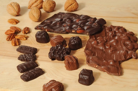 pecans: Assortment of chocolates, almond bark, walnuts, and pecans