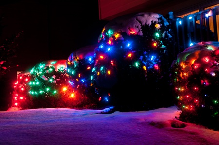 christmas display: Outdoor Christmas lights casting a colorful glow on the snow
