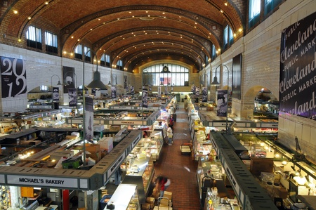 aisles: Cleveland, Ohio - June 27, 2012: The famed West Side Market, celebrating 100 years of continuous operation in 2012, opens for business in the early morning.