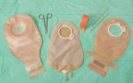 colostomy: Three ileostomy pouches with scissors and tape