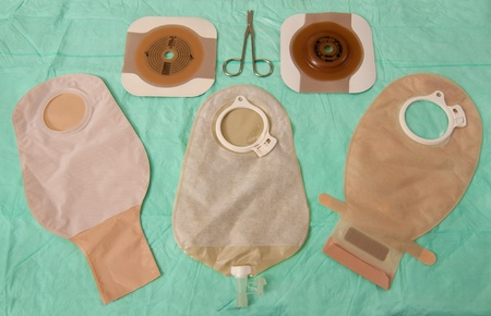 colostomy: Tree ileostomy bags of differing types with barrier rings and scissors