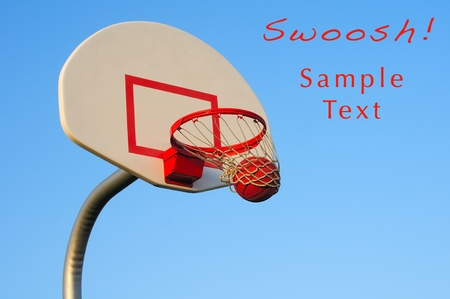 A basketball shot swishes through an outdoor hoop, with sample text