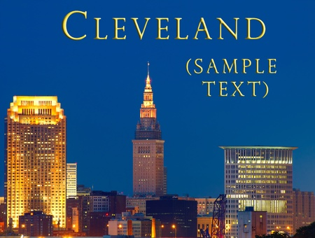 Close in view of downtown Cleveland lit up at night, just after sunset, with sample text photo