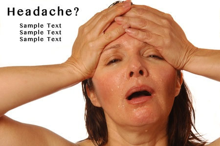 splitting headache: Woman with splitting headache holding hands on forehead, with sample text