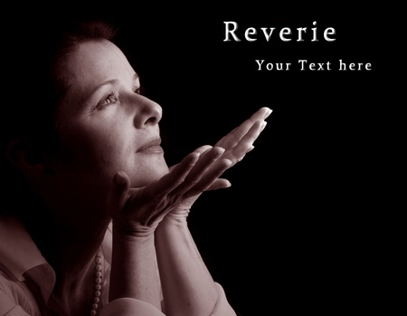 black worship: A beautiful woman in spiritual reverie, sepia with sample text Stock Photo