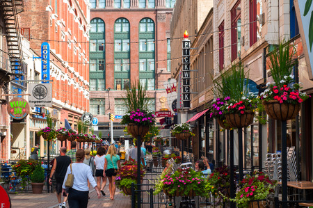 venues: Cleveland, Ohio - August 10, 2013  The trendy scene of East Fourth Street in Cleveland with its clubs, cafes, and entertainment venues attracts visitors even on a Saturday morning  Editorial
