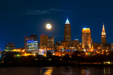 Brightly lit Cleveland Ohio under a just risen full moon