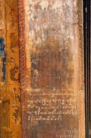 Chinese and Khmer graffiti on temple wall at Angkor Wat, Cambodia photo