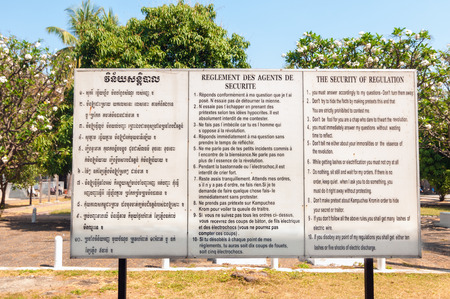 regime: Phnom Penh, Cambodia - February 28, 2014  A sign in Khmer, French, and English reproduces the interrogation rules read to prisoners at the Tuol Sleng prison during the Pol Pot regime  The prison is now a museum  Editorial