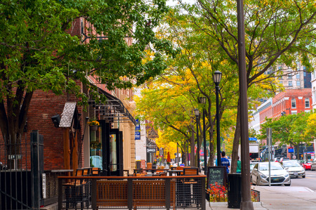 awnings: CLEVELAND, OH - OCTOBER 5: The trendy club and restaurant district of West 6th Street in Cleveland Ohio, with al fresco dining on the sidewalks, begins to come alive on an October morning.