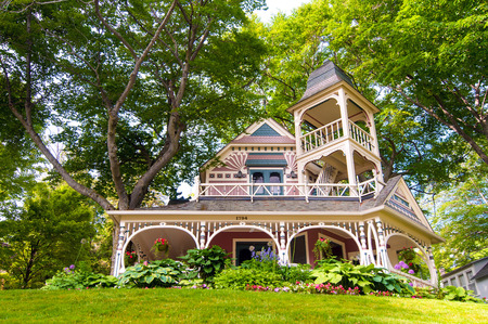 ornately: BAY VIEW, MI - JUNE 26, 2014: This ornately decorated house is one of many quaint old residences in the resort village of Bay View, once a Methodist camp retreat, next to Petoskey on Lake Michigan. Editorial