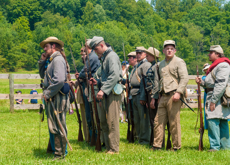 hale: BATH, OH, USA - AUGUST 9, 2014  Confederate soldier reenactors line up to march into battle at a Civil War reenactment of the 3rd Battle of Winchester  1864  at Hale Farm and Village in Ohio  Editorial