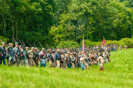 BATH, OH, USA - AUGUST 9, 2014  Confederate soldier reenactors march into battle formation at a Civil War reenactment of the 3rd Battle of Winchester  1864  at Hale Farm and Village in Ohio