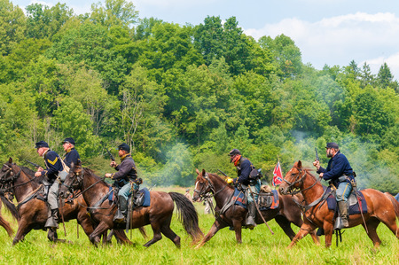 hale: BATH, OH, USA - AUGUST 9, 2014  Union cavalry troops sweep past Confederates at the climax of the 3rd Battle of Winchester  1864  in a Civil War reenactment at Hale Farm and Village in Ohio  Editorial