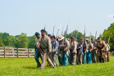 hale: BATH, OH, USA - AUGUST 9, 2014: Confederate soldier reenactors march into battle at a Civil War reenactment of the 3rd Battle of Winchester (1864) at Hale Farm and Village in Ohio. Editorial