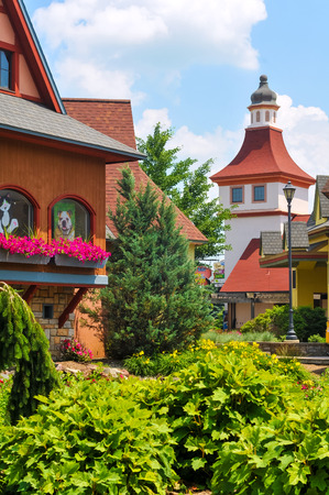 recently: FRANKENMUTH, MI - JUNE 28, 2014: German-style architecture forms the backdrop of River Place, a recently established collection of shops and attractions in this Michigan town known best for Christmas and German food.
