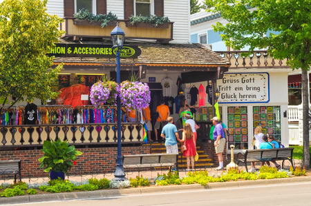 middle america: FRANKENMUTH, MI - JUNE 28, 2014: German-style architecture and culture along Main Streen in this small town in middle America attract throngs of visitors every year.